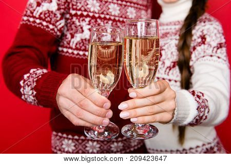 Focused Close Up Shot Of Festive Amazed Friends With Stemware Of Martini Bonding In Knitted Traditio