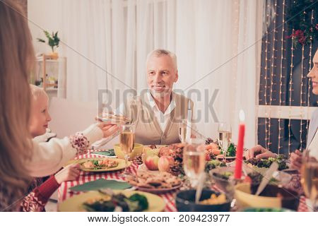 Close up cropped view of handsome grandad with relatives setted festive desktop full of yummy treats they wear knitted traditional x mas costumes enjoy chat joke share