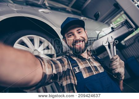 Attractive Brunet Bearded Automotive Expert With Beaming Smile Makesphoto With Metal Mechanical Keys