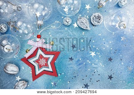Christmas Decorations With Star And Silvery Nuts On Blue Glitter Background