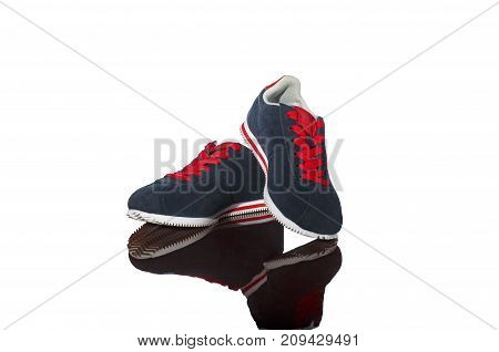 pair of new blue sneakers isolated on white background. specular background