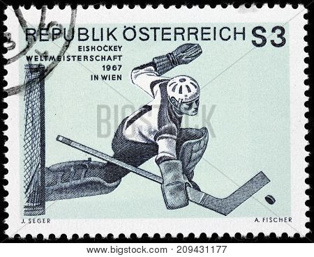 LUGA RUSSIA - AUGUST 20 2017: A stamp printed by AUSTRIA shows Ice hockey goaltender World Championship Ice Hockey circa 1967