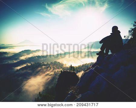 Hiker Man Take A Rest On Mountain Peak. Man Lay On Summit, Bellow Autumn Valley.
