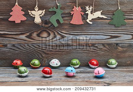 Christmas decoration hanging over wooden background and jingle bells