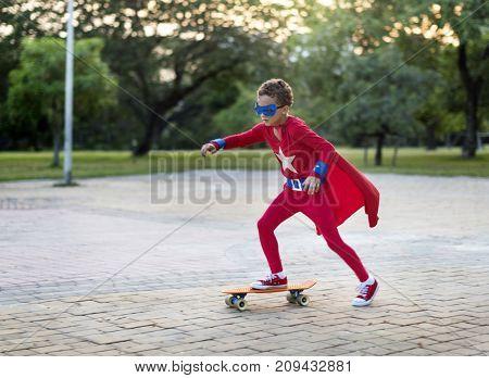 Superhero boy on a skateboard