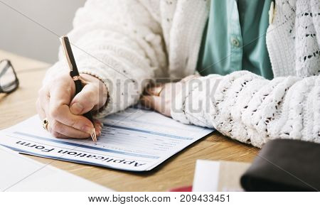 Pensioner filling out a form