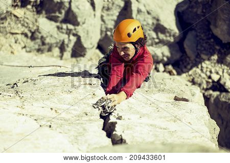 The climber makes an ascent to a large wall.