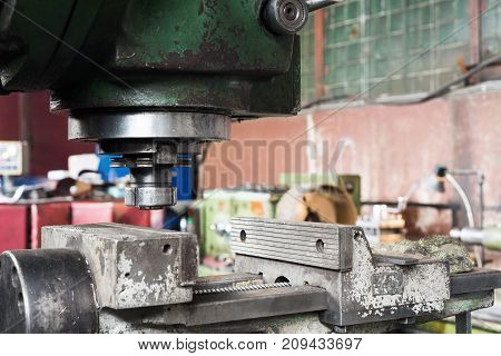 Working part of a vintage milling machine.