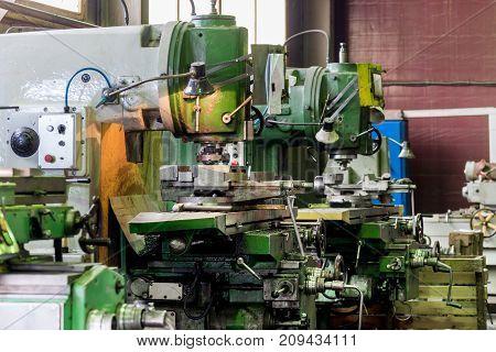 Mechanical vertical milling machine. Shop metal processing plant.