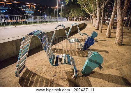 SYDNEY,NSW,AUSTRALIA-NOVEMBER 21,2016: Exercise bikes at Tumbalong Park in Darling Quarter at night in Sydney, Australia