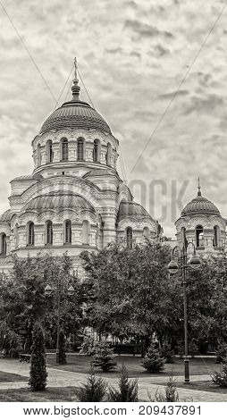 Christian cathedral of the 18th century. The sky with clouds. Russia. Byzantine style. Architecture. Vertical format. Outdoors. Photo. Sepia.