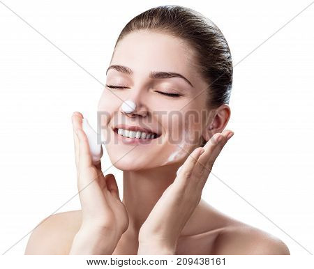 Young woman cleanses skin with foam isolated on white background. Skin care concept.