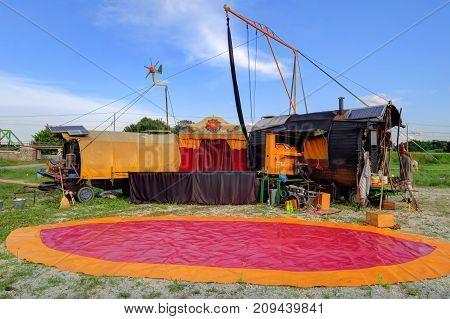 PTUJ SLOVENIA - JUNE 28 : A circus performer two caravans and an aerial rig prepare for an outdoor the Circo Soluna performance in Ptuj Slovenia.