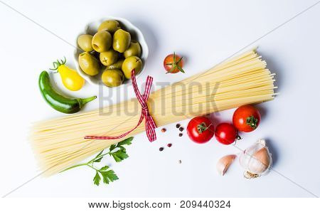 Uncooked Pasta With Ingredients On White