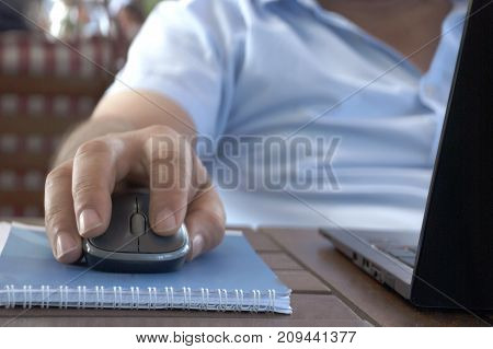 Computer mouse close-up male hand. Male business man hand on a computer mouse close up