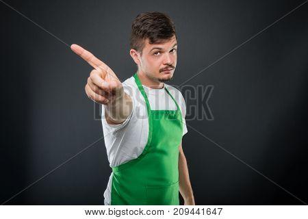 Portrait Of Attractive Supermarket Employer Showing No Gesture