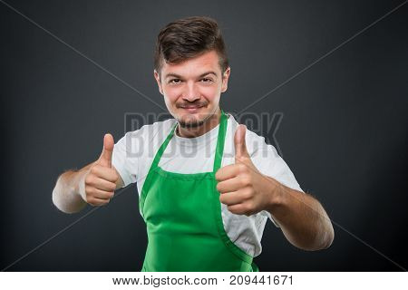 Portrait Of Attractive Supermarket Employer Showing Double Like