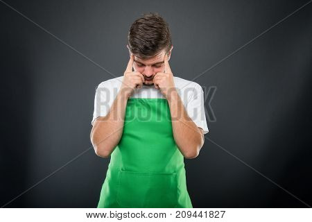 Supermarket Employer Standing With Fingers On Head Like Thinking