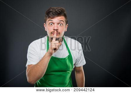 Supermarket Employer Posing Showing Silence Gesture