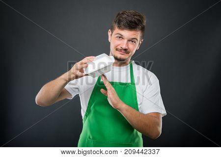 Supermarket Employer Making Break Gesture With Lunch Box