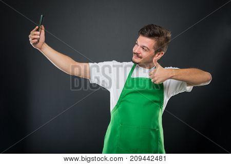 Portrait Supermarket Employer Taking Selfie Showing Like