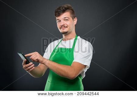 Portrait Supermarket Employer Holding Smartphone And Texting