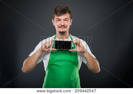 Portrait Supermarket Employer Holding Smartphone And Smiling