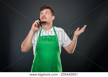 Portrait Supermarket Employer Explaining Something At Telephone