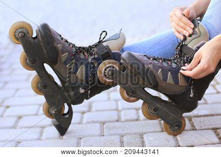 Legs of roller skater, outdoors