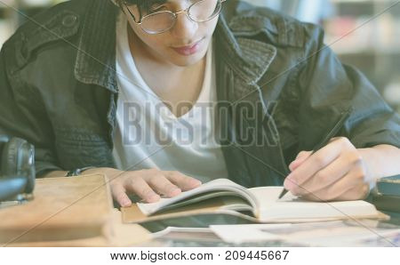Student writing on a notebook