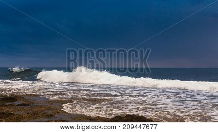Landscape: The dark sky above the sea foam. Cyprus.