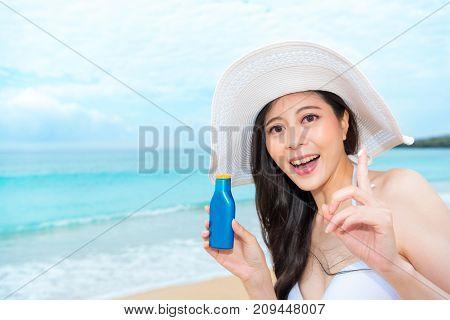 Happy Beautiful Woman Holding Uv Cream Bottle