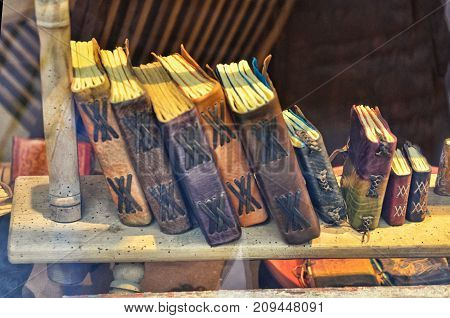 Beautiful antique and vintage books on old wooden bookshelf in book shop or library. Vintage retro toned image with copy space