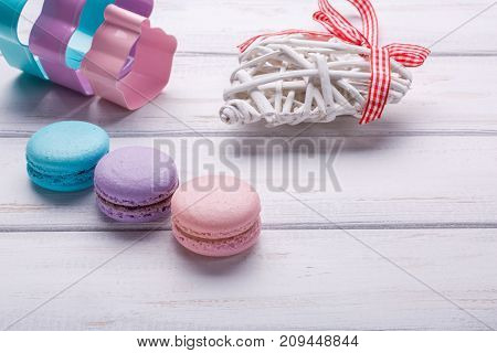 Sweet and colorful french macaroons or macarons was placed on wooden white Background. dessert for St Valentine's Day. Place or space for text