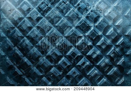 Dense thick window glass texture with rhombus pattern close-up