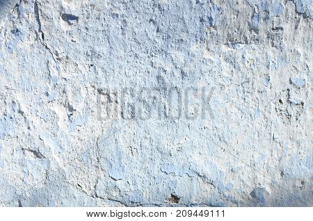 Shabby rural whitewash wall textured background close-up