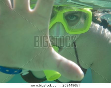 woman is engaged in snorkeling in the warm sea
