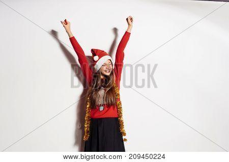 New Year's holidays, Santa Claus hat, New Year's mood, Christmas, beautiful festive sweater, happy girl
