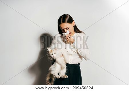 long-haired girl allergic to cat, isolated on white background, white cat