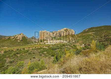 Wide angle view of the old town built below Aguero Mountains, Huesca, Spain