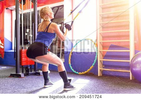 Blonde Fitness Woman Training With Fitness Straps