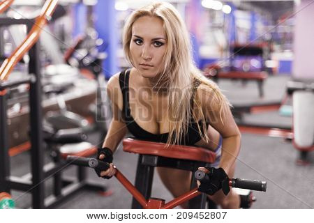 Sporty sexy woman training in gym. lifestyle