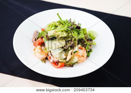 Greek salad with feta cheese and smoked shrimp