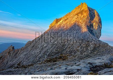 Fantastic sunrise on top of rocky mountain St John's peak during morning at the summit of Mount Kinabalu,Sabah,Malaysia.