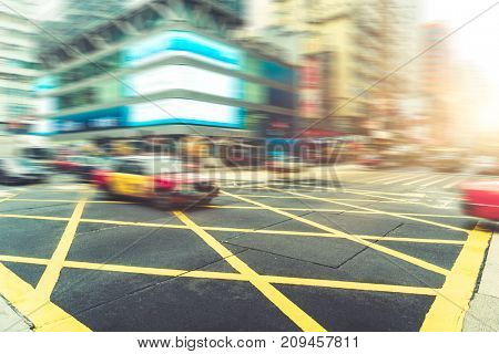 taxi on city street,hong kong,china,asia.