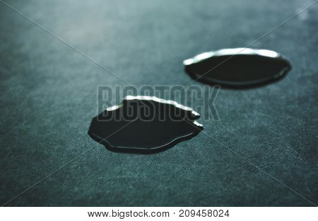 drop of water rolling on black tile counter