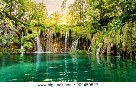Sunset over a waterfall in Plitvice Lakes National Park, Croatia