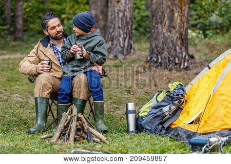 Father And Son In Camping With Tent