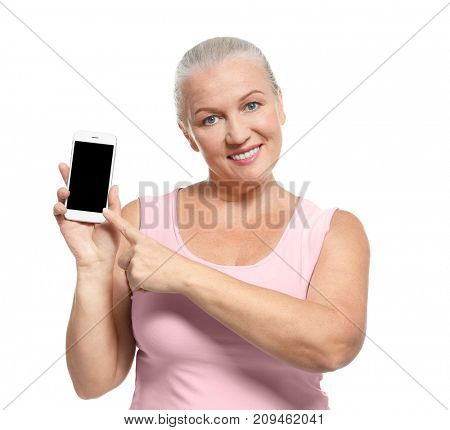 Senior woman with her cell phone, isolated on white