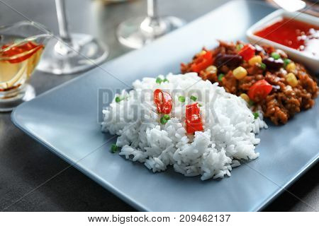 Chili Con Carne with rice on plate, close up